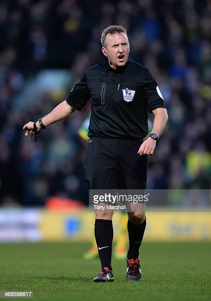 Referee Jonathan Moss during the Barclays Premier League match between Norwich City and Manchester City at Carrow Road on February 8 2014 in Norwich...