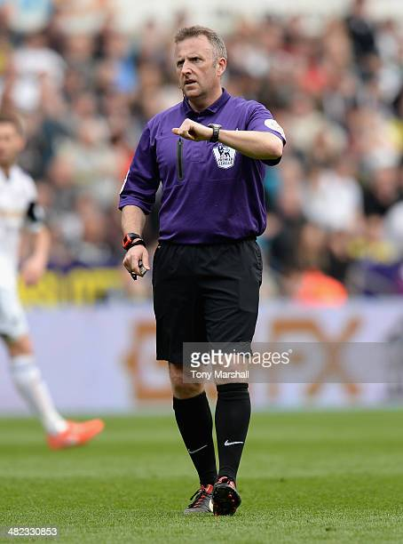 Referee Jonathan Moss during the Barclays Premier League match between Swansea City and Norwich City at Liberty Stadium on March 29 2014 in Swansea...