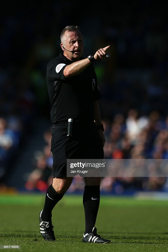 Referee Jonathan Moss gestures during the Premier League match between Everton and Southampton at Goodison Park on May 5, 2018 in Liverpool, England.