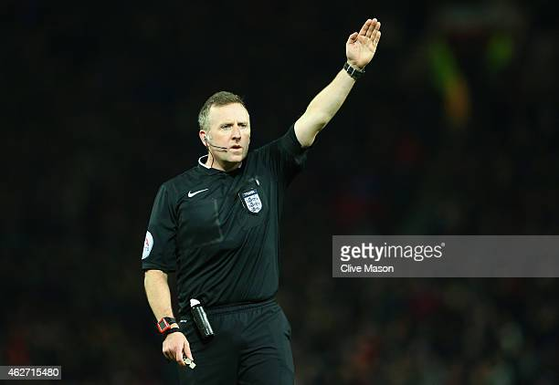 Referee Jonathan Moss in action duri ng the FA Cup Fourth round replay match between Manchester United and Cambridge United at Old Trafford on...