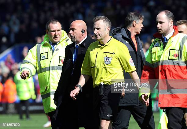 Referee Jonathan Moss is escorted off the pitch after the Barclays Premier League match between Leicester City and West Ham at the King Power Stadium...