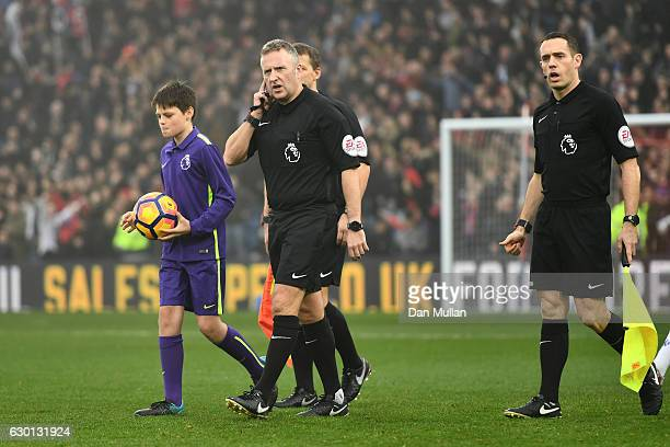 Referee Jonathan Moss leads the teams out prior to kick off during the Premier League match between Crystal Palace and Chelsea at Selhurst Park on...