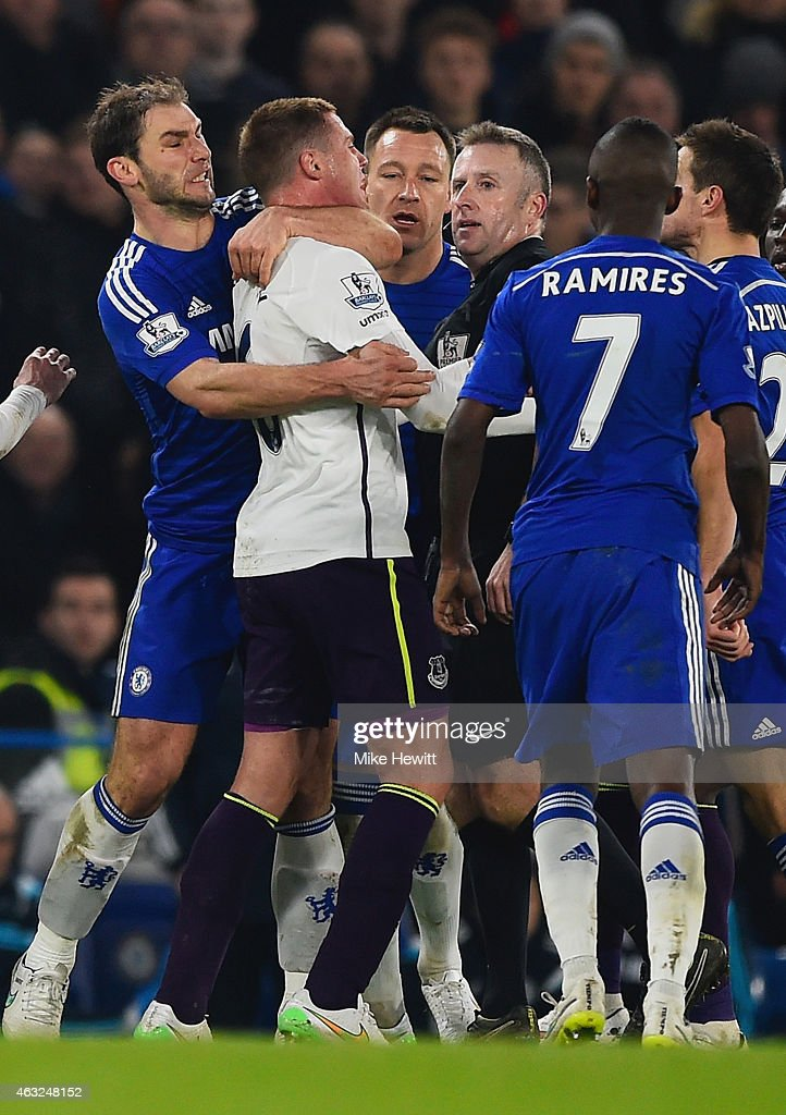 Referee Jonathan Moss looks on as Branislav Ivanovic of Chelsea clashes with James McCarthy of Everton during the Barclays Premier League match between Chelsea and Everton at Stamford Bridge on February 11, 2015 in London, England.