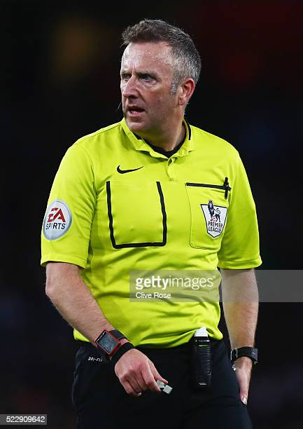 Referee Jonathan Moss looks on during the Barclays Premier League match between Arsenal and West Bromwich Albion at the Emirates Stadium on April 21...