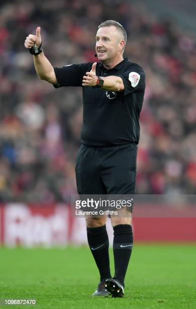 Referee Jonathan Moss looks on during the Premier League match between Liverpool FC and Crystal Palace at Anfield on January 19 2019 in Liverpool...