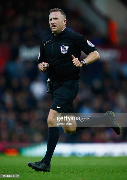 Referee Jonathan Moss runs during the Barclays Premier League match between West Ham United and Chelsea at Boleyn Ground on October 24 2015 in London...