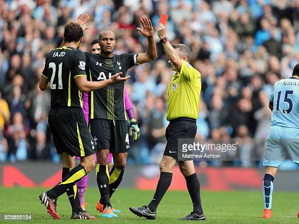 Referee Jonathan Moss sends off Federico Fazio of Tottenham Hotspur for a foul in the box