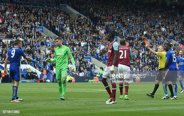Referee Jonathan Moss sends off Jamie Vardy of Leicester City during the Barclays Premier League match between Leicester City and West Ham United at...