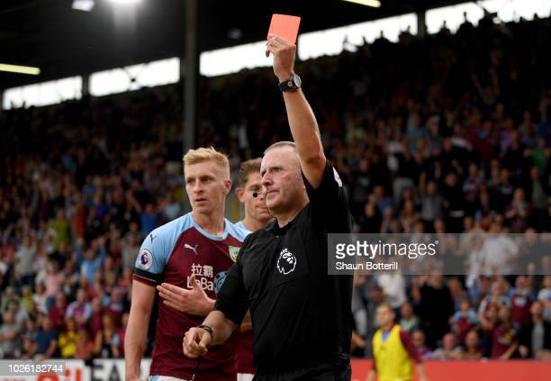 Referee Jonathan Moss shows a red card to Marcus Rashford of Manchester United during the Premier League match between Burnley FC and Manchester...
