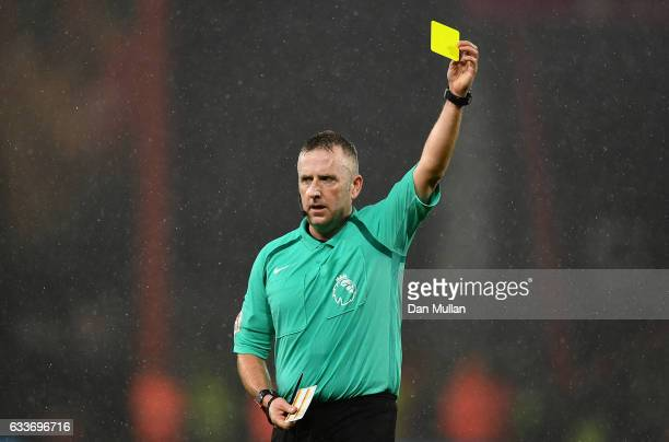 Referee Jonathan Moss shows a yellow card during the Premier League match between AFC Bournemouth and Crystal Palace at Vitality Stadium on January...