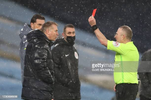 Referee Jonathan Moss shows the red card to Aston Villa's English head coach Dean Smith during the English Premier League football match between...