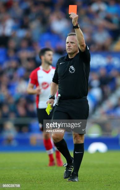 Referee Jonathan Moss shows the Red card to Maya Yoshida of Southampton during the Premier League match between Everton and Southampton at Goodison...
