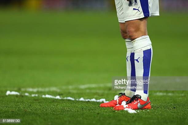 Referee Jonathan Moss sprays vanishing form on the boots of Marc Albrighton of Leicester City during the Barclays Premier League match between...