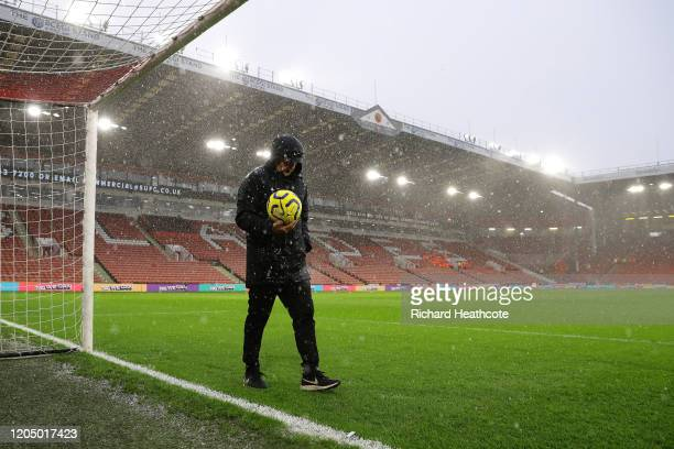 Referee Jonathan Moss tests the pitch and goal line technology in the rain prior to the Premier League match between Sheffield United and AFC...