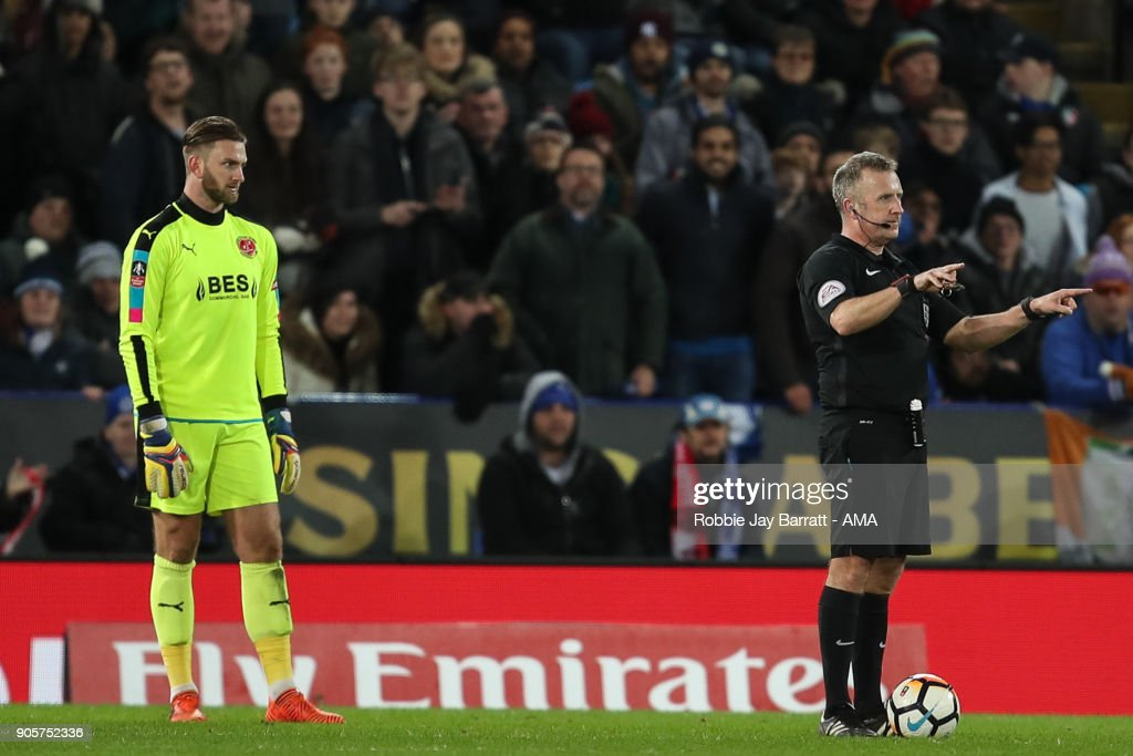 Referee Jonathan Moss uses the VAR during The Emirates FA Cup Third Round Replay match between Leicester City and Fleetwood Town at The King Power Stadium on January 16, 2018 in Leicester, England.