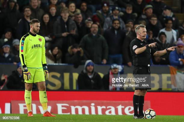 Referee Jonathan Moss uses the VAR during The Emirates FA Cup Third Round Replay match between Leicester City and Fleetwood Town at The King Power...