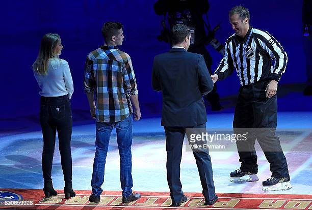 Referee Jonny Murray is honored for officiating his 1000th NHL game between the Florida Panthers and the Montreal Canadiens at BBT Center on December...
