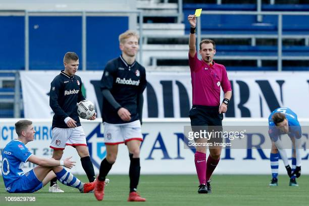 referee Jordin Brouwer gives a yellow card during the match between PEC Zwolle U19 v FC Emmen U19 at the MAC3PARK Stadion on December 8 2018 in...