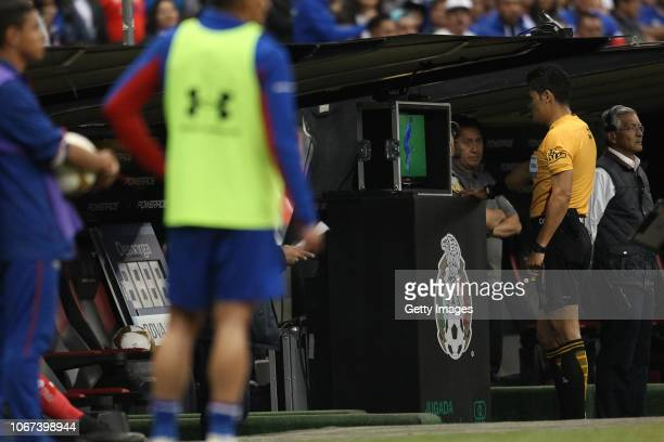 Referee Jorge Antonio Perez Duran watches the VAR during the quarter final second leg match between Cruz Azul and Queretaro as part of the Torneo...