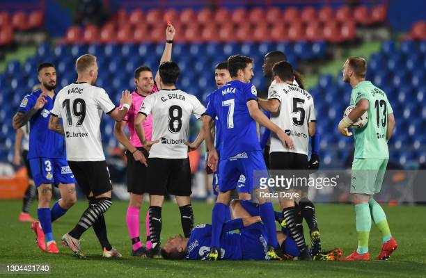 Referee, Jorge Figueroa Vazquez shows Mouctar Diakhaby of Valencia CF a red card during the La Liga Santander match between Getafe CF and Valencia CF...