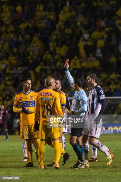 Referee Jorge Isaac Rojas gives a red card to Hugo Ayala of Tigres during the first leg of the Torneo Apertura 2017 Liga MX final between Tigres UANL...