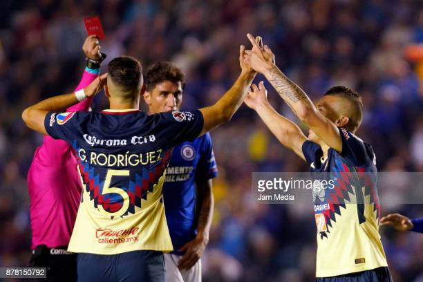 Referee Jorge Rojas shows the red card to Mateus Uribe of America during the quarter finals first leg match between Cruz Azul and America as part of...