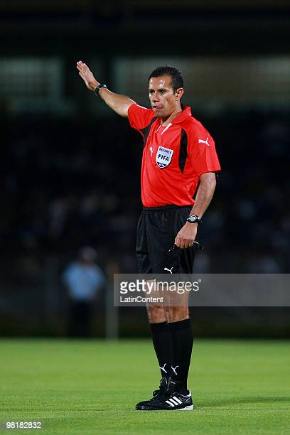 Referee Jose Alfredo Penaloza during the Concacaf Champions League semifinal match between Pumas v Cruz Azul at the Olimpyc Stadium on March 31, 2010...