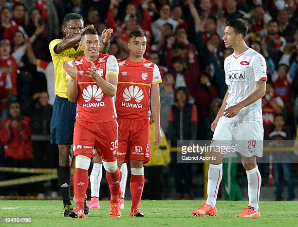 Referee Jose Argote whistles the end of the match as Yeison Gordillo of Santa Fe celebrates qualifying to the next round after a second leg Quarter...