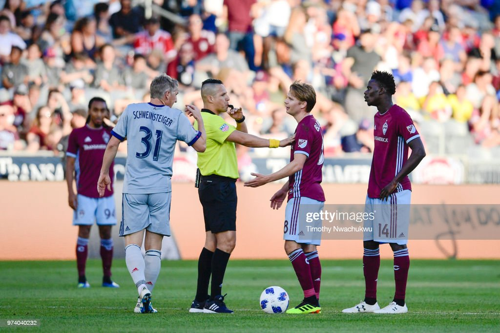 Referee Jose Carlos Rivero separates Bastian Schweinsteiger #31 of Chicago Fire and Johan Blomberg #8 of Colorado Rapids after a foul against Blomberg at Dick's Sporting Goods Park on June 13, 2018 in Commerce City, Colorado.
