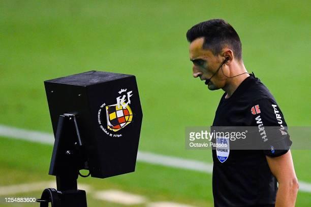 Referee Jose Maria Sanchez Garcia reviews an action on the VAR screen during the Liga match between RC Celta de Vigo and Club Atletico de Madrid at...