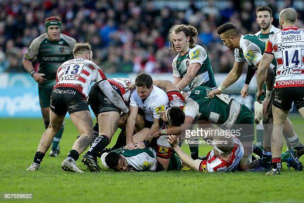 Referee JP Doyle gets caught in a ruck during the Aviva Premiership match between Gloucester Rugby and Leicester Tigers at Kingsholm Stadium on...