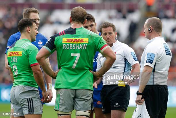 Referee JP Doyle shows a yellow card to Danny Care of Harlequins and Liam Williams of Saracens during the Gallagher Premiership Rugby match between...