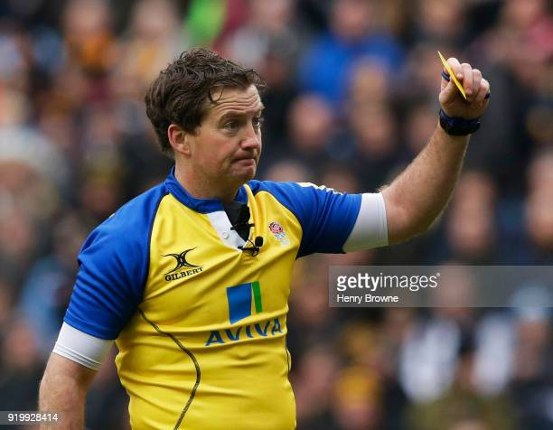 Referee JP Doyle shows a yellow card to Jonny Hill of Exeter Chiefs during the Aviva Premiership match between Wasps and Exeter Chiefs at The Ricoh...