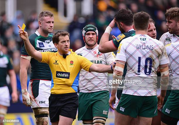 Referee JP Doyle shows the yellow card to Eamon Sheridan of London Irish during the Aviva Premiership match between London Irish and Leicester Tigers...