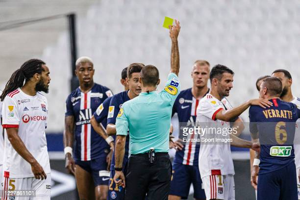Referee Jérôme Brisard shows a yellow card for Ander Herrera of Paris Saint Germain during the French League Cup final between Paris Saint Germain...