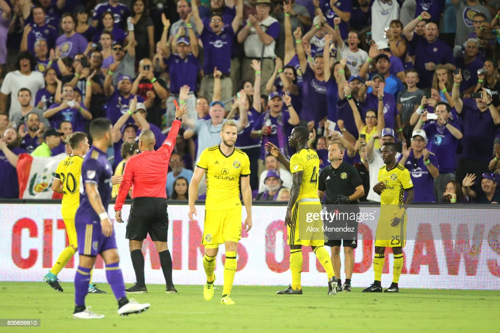 Referee Juan Guzman Jr. calls a red card on Harrison Afful #25 of Columbus Crew SC after looking at a video review during a MLS soccer match between the Columbus Crew SC and the Orlando City SC at Orlando City Stadium on August 19, 2017 in Orlando, Florida.