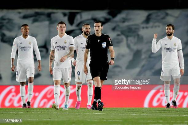 Referee Juan Martinez Manuera Eder Militao of Real Madrid, Toni Kroos of Real Madrid, Karim Benzema of Real Madrid, Nacho of Real Madrid Disappointed...