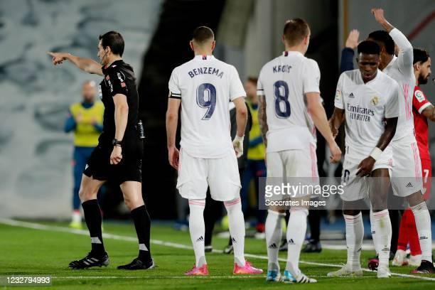 Referee Juan Martinez Manuera gives a penalty to Sevilla after a VAR decision Karim Benzema of Real Madrid,Toni Kroos of Real Madrid,Vinicius Junior...