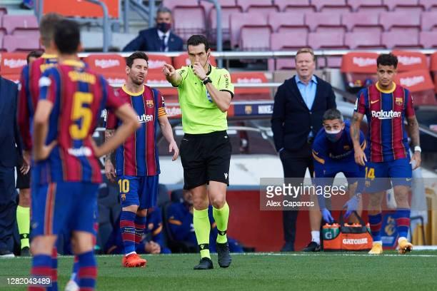 Referee Juan Martinez Munuera awards Real Madrid CF a penalty following a VAR review during the La Liga Santander match between FC Barcelona and Real...
