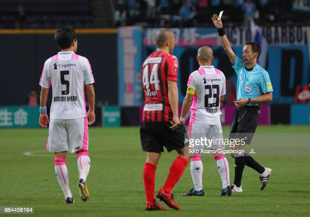Referee Jumpei Iida shows a yellow card during the JLeague J1 match between Consadole Sapporo and Sagan Tosu at Sapporo Dome on December 2 2017 in...