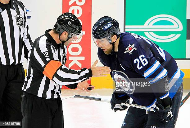 Referee Justin St Pierre gives Blake Wheeler of the Winnipeg Jets an explanation of a call during a second period stoppage in play against the...