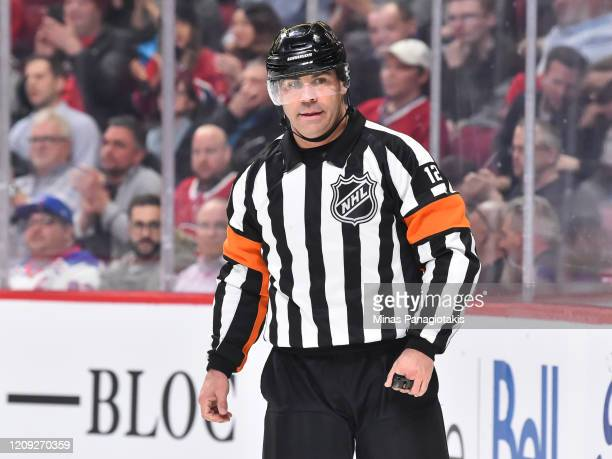 Referee Justin St Pierre officiates his 1000th career NHL game during the third period between the Montreal Canadiens and the New York Rangers at the...