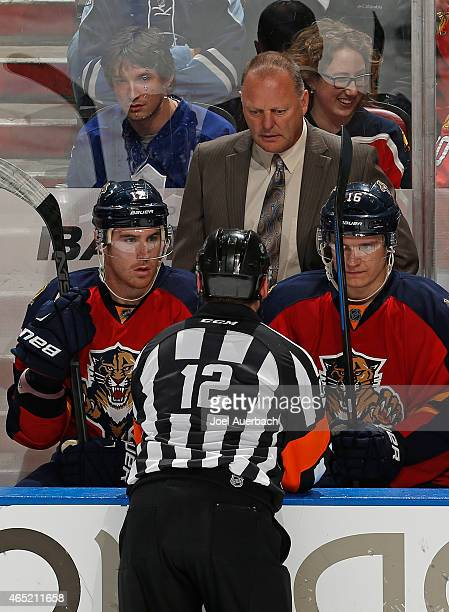 Referee Justin St Pierre talks to Head coach Gerald Gallant of the Florida Panthers after goaltender Al Montoya was injured during third period...