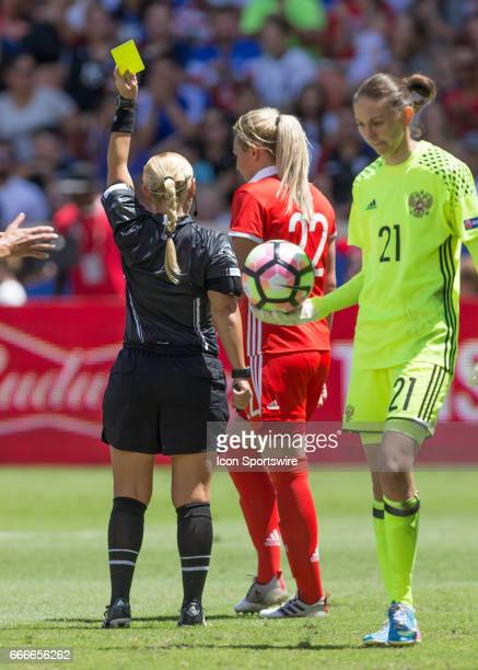 Referee Karen Abt issues a yellow card to Nelli Korovkina forward of Russia during the soccer match between Russia and USA on April 9 2017 at BBVA...