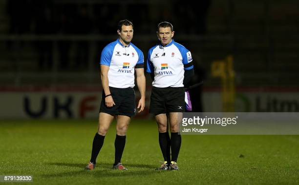 Referee Karl Dickson and his assistant referee Wayne Falla reviews a video replay during the Aviva Premiership match between Sale Sharks and...