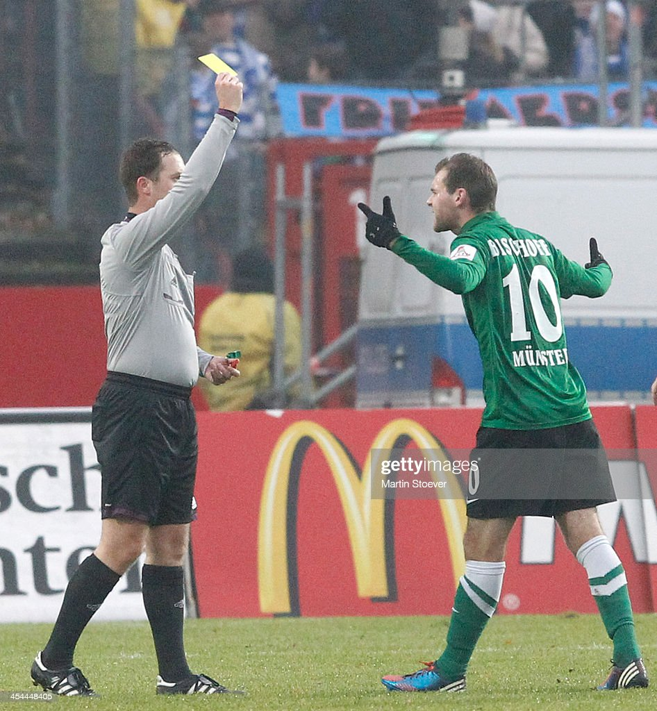 Referee Karl Valentin reacts during the Third League match between Preussen Muenster and MSV Duisburg at Preussenstadion on December 7, 2013 in Muenster, Germany.