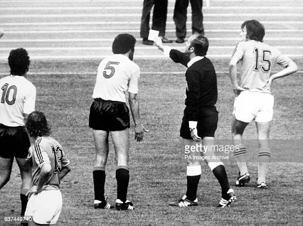 Referee Karoly Palotai sends off Uruguay's Julio Montero Castillo after he allegedly punched Holland's Rob Rensenbrink in the stomach