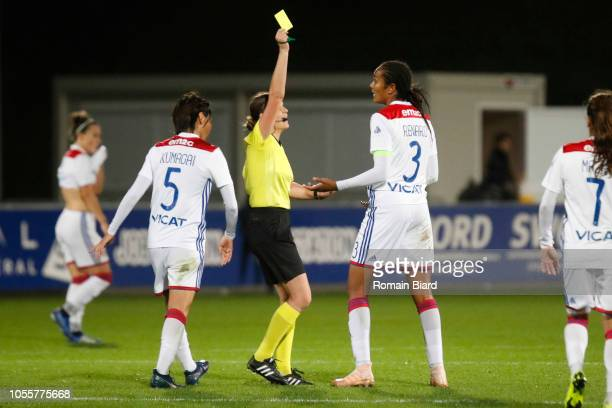 Referee Katalin Kulcsar gives Wendie Renard of Lyon a yellow card during the UEFA Women's Champions League match between Lyon and Ajax Amsterdam on...