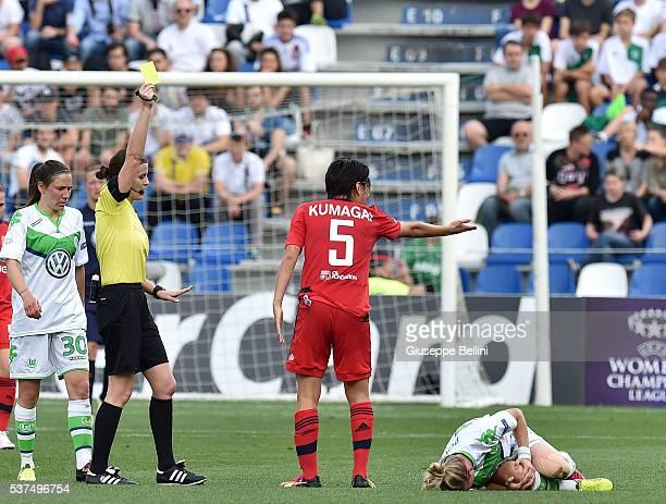 Referee Katalin Kulcsar shows the yellow card to Saki Kumagai of Olympique Lyonnais during UEFA Women's Champions League Final between VfL Wolfsburg...