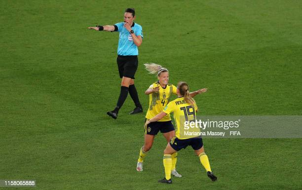 Referee Kate Jacewicz blows the final whistle as Hanna Glas and Anna Anvegard of Sweden celebrate following their sides victory in the 2019 FIFA...